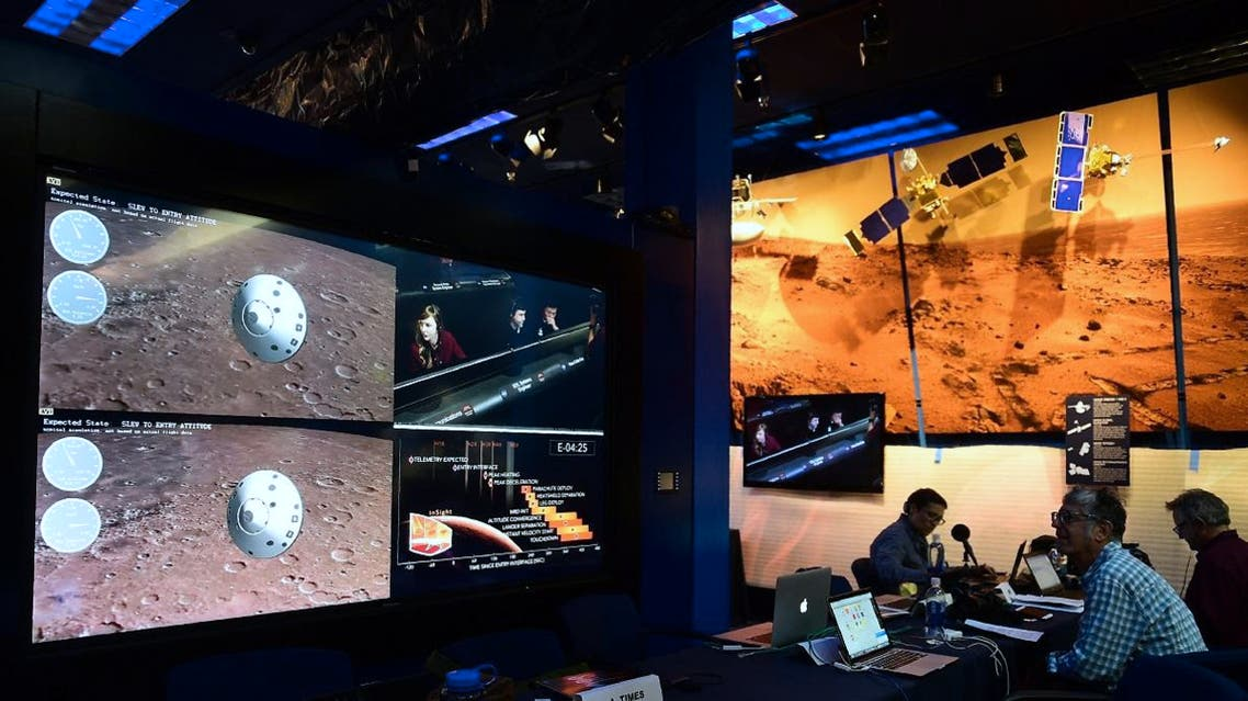 People watch the landing of NASA's InSight spacecraft on the planet Mars on television screens at NASA's Jet Propulsion Laboratory (JPL) in Pasadena. (AFP)