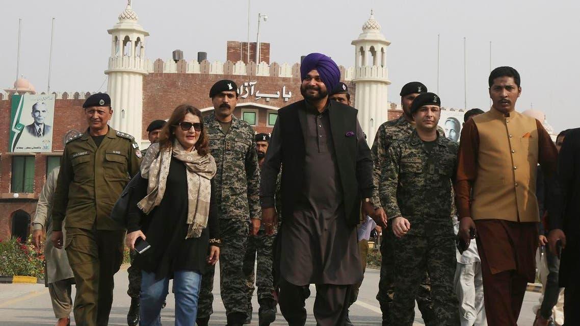 Former Indian cricketer-turned-politician Navjot Singh Sidhu, (center), arrives at the Pakistani border post Wagha near Lahore, Pakistan, on November 27, 2018.  (AP)