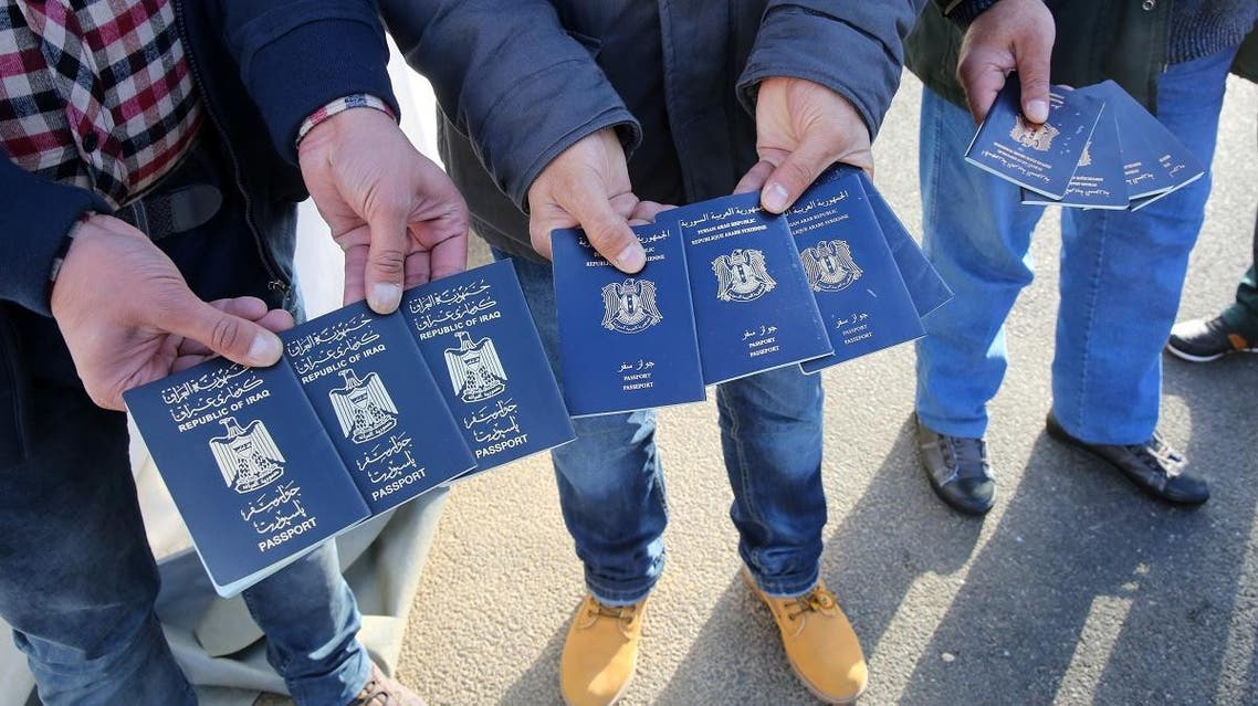 passports from Iraqi and Syrian (AFP)