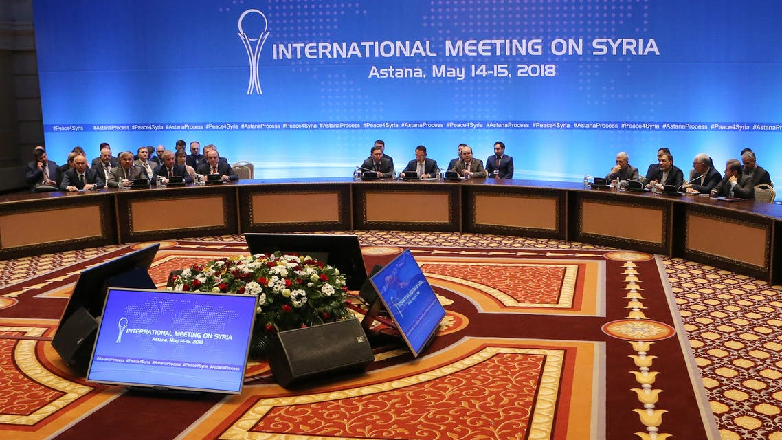 A general view of shows Syrian regime representatives, opposition delegates and other attendees as they take part in the plenary session of Syria peace talks brokered by Iran, Russia and Turkey in Astana on May 15, 2018.