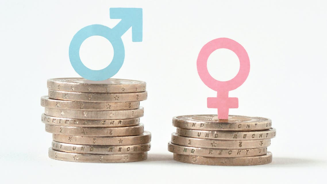 Male and female symbols on piles of coins - Gender pay equality concept - Stock image