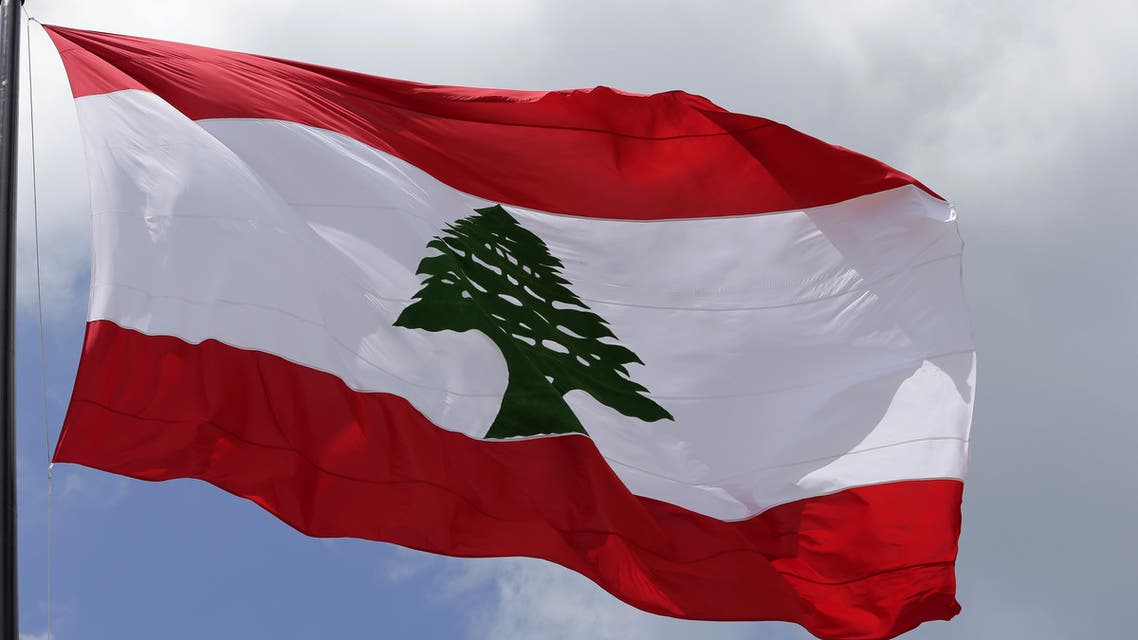 A picture taken on May 6, 2016 shows a giant Lebanese flag fluttering in Martyrs square in central Beirut at the occasion of the 100 years since the hanging in public of several Lebanese nationalists who opposed the Ottoman rule during World War I on May 6, 1916.