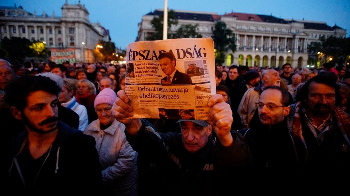 A man shows the last printed edition of Nepszabadsag during a demonstration organised to express solidarity with Hungarian political daily Nepszabadsag in Budapest, Hungary. (File photo: AP)