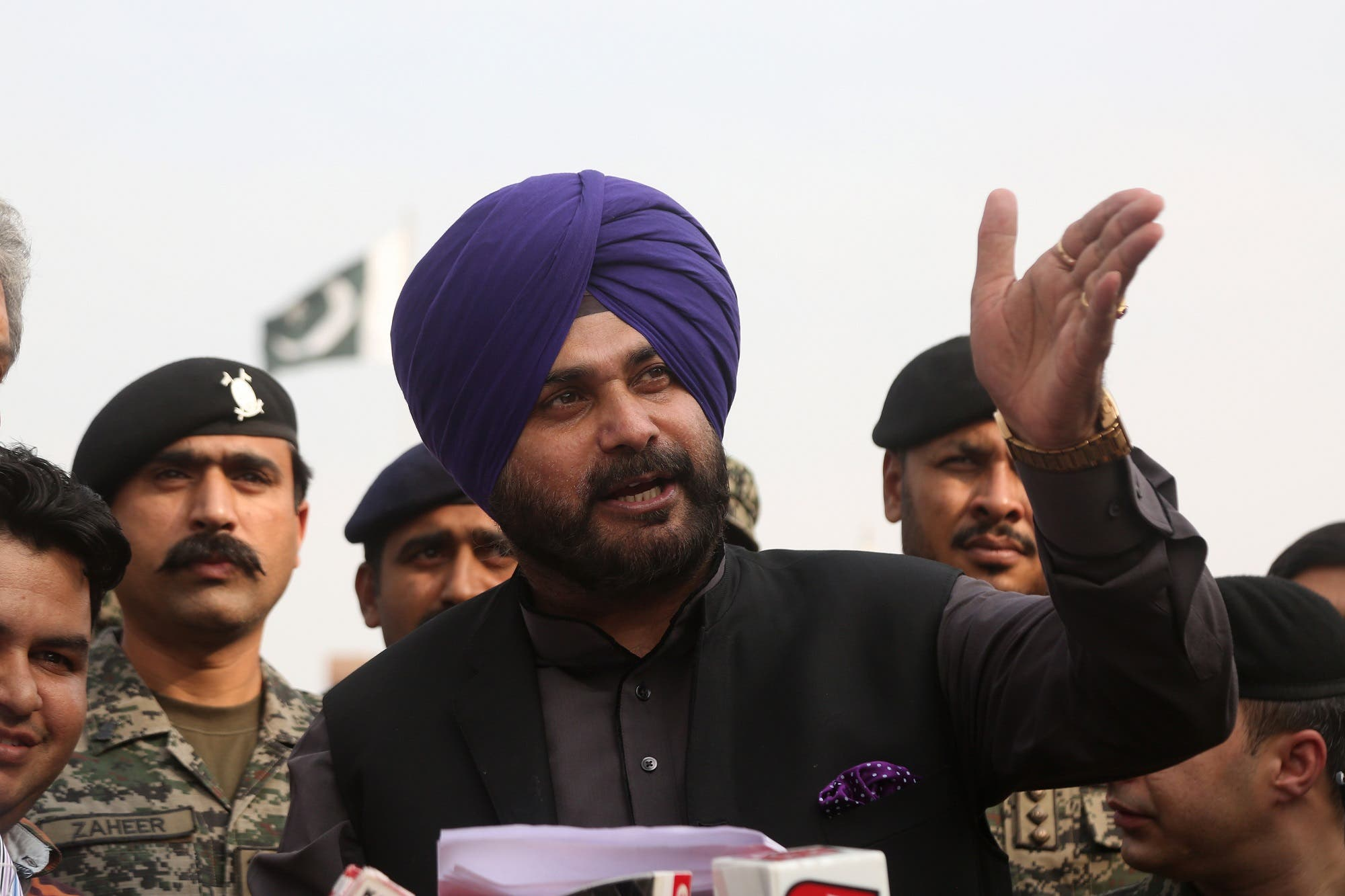 Indian cricketer-turned-politician Navjot Singh Sidhu speaks to journalists after entering Pakistan from India at the border crossing in Wagah on November 27, 2018. (AFP)