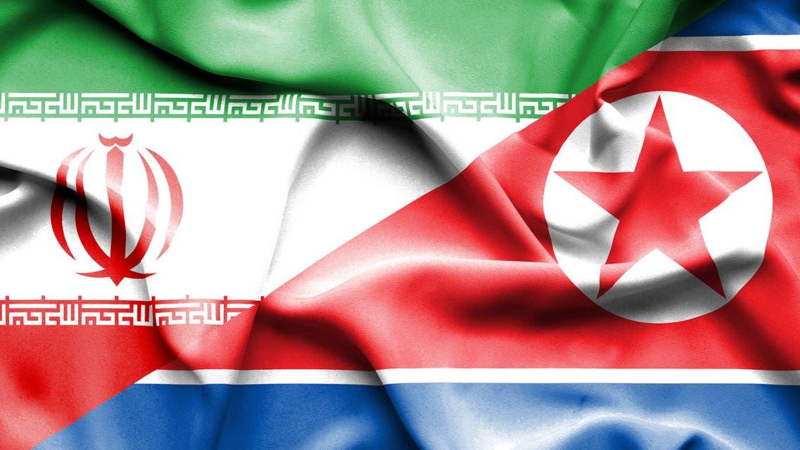 Waving flag of North Korea Iran - Stock image
