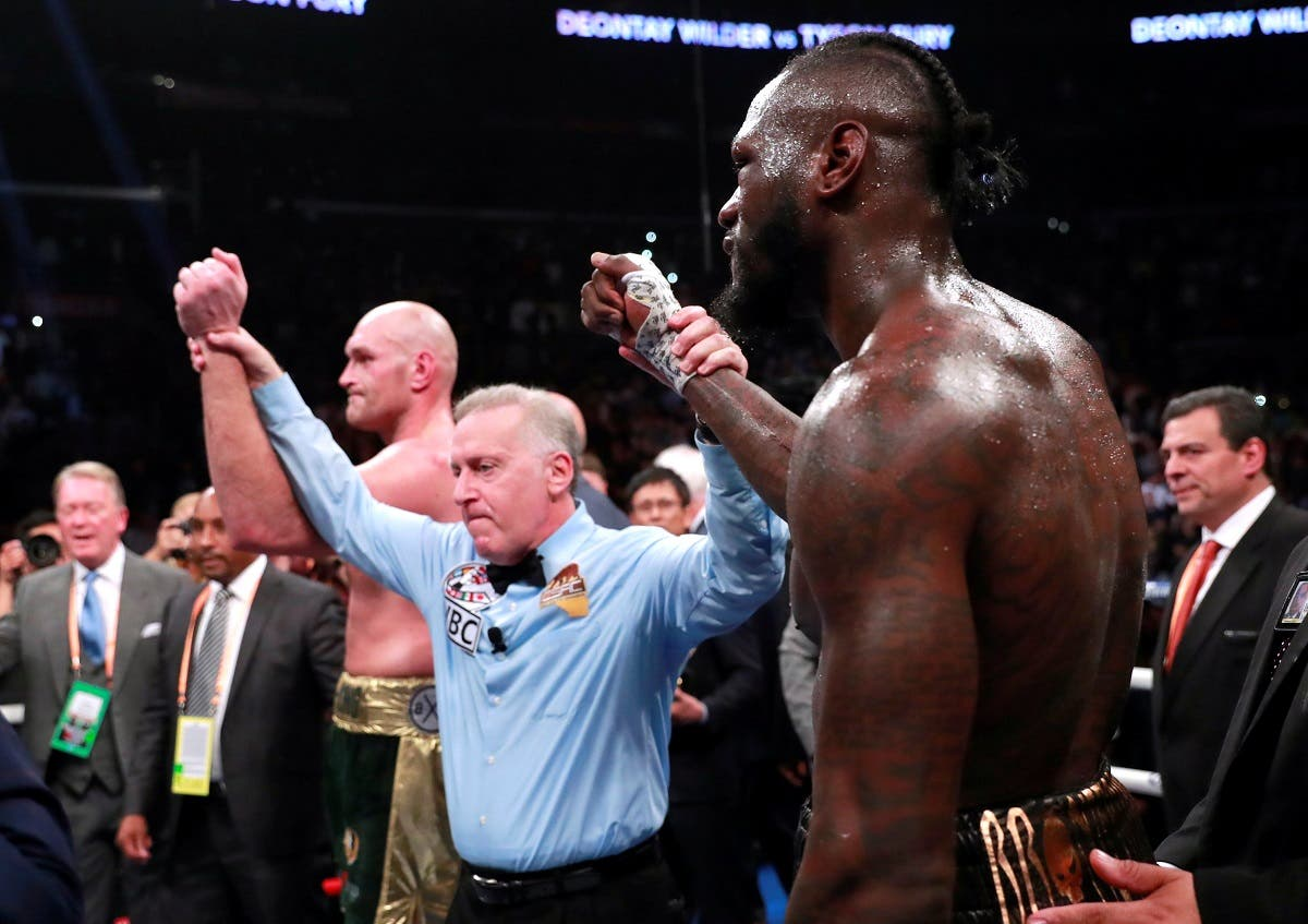 Deontay Wilder and Tyson Fury. (Reuters)