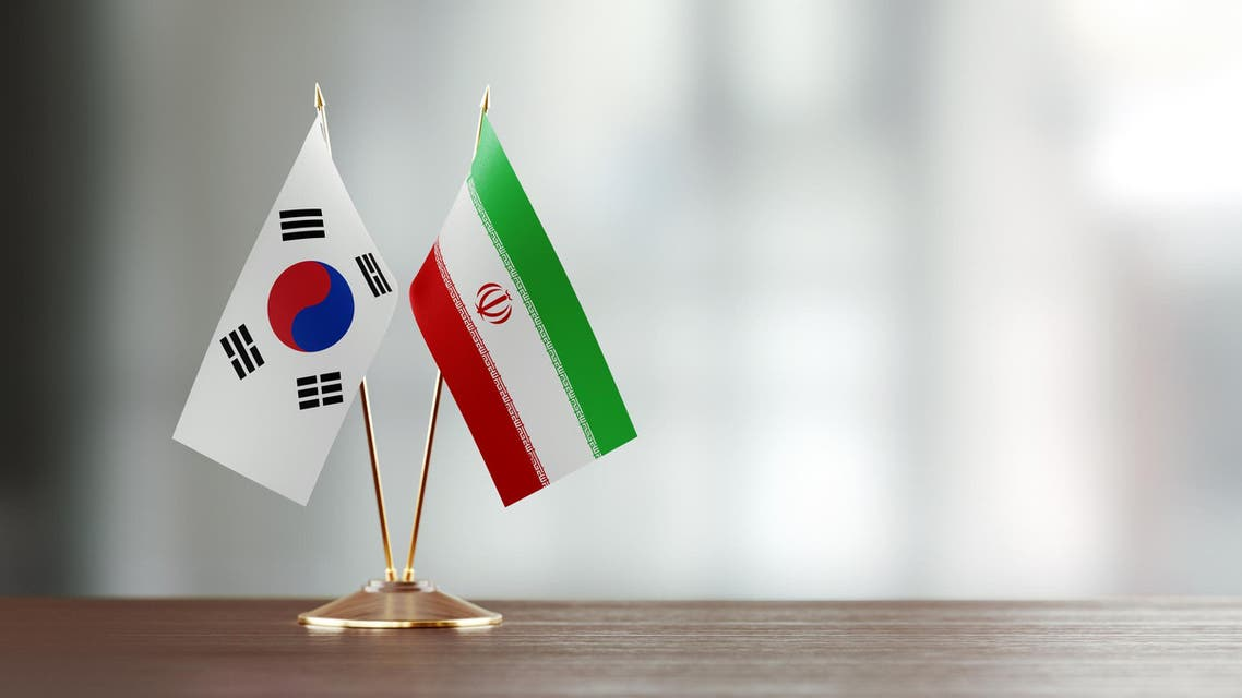 South Korean and Iranian flag pair on a desk. (Stock image)