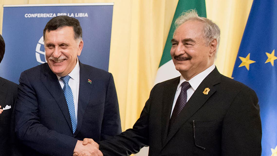 This photo taken and handout on November 13, 2018 by the Italian prime minister Palazzo Chigi's press office, shows Italian Prime Minister Giuseppe Conte (C), head of the UN-backed unity government in Tripoli, Prime Minister Fayez al-Sarraj (2ndR), self-proclaimed Libyan National Army (LNA) Chief of Staff, Khalifa Haftar (R), EU President Donald Tusk (2ndL) and Russian Prime Minister Dmitry Medvedev (L) meeting on the sidelines of an international conference on Libya in Palermo. Eastern Libyan strongman Khalifa Haftar said on November 13 he will not join other key players at Palermo talks to try to stabilise the North African nation, casting a shadow over the latest international bid to kick-start a long-stalled political process and trigger elections.