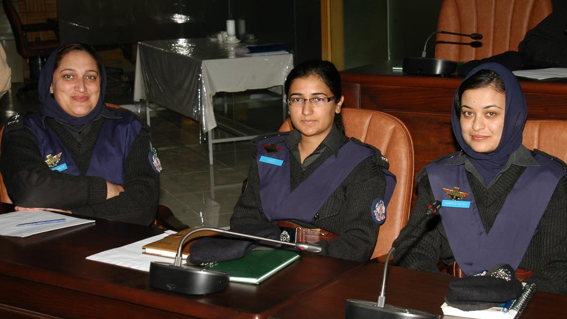 ASP Suhai Aziz (center) with colleagues in Karachi, Pakistan. (Supplied)
