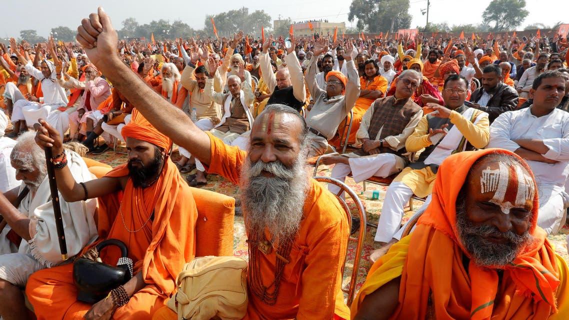 "Hindu holymen shout slogans during ""Dharma Sabha"" organized by the Vishva Hindu Parishad (VHP) in Ayodhya on November 25, 2018. (Reuters)"