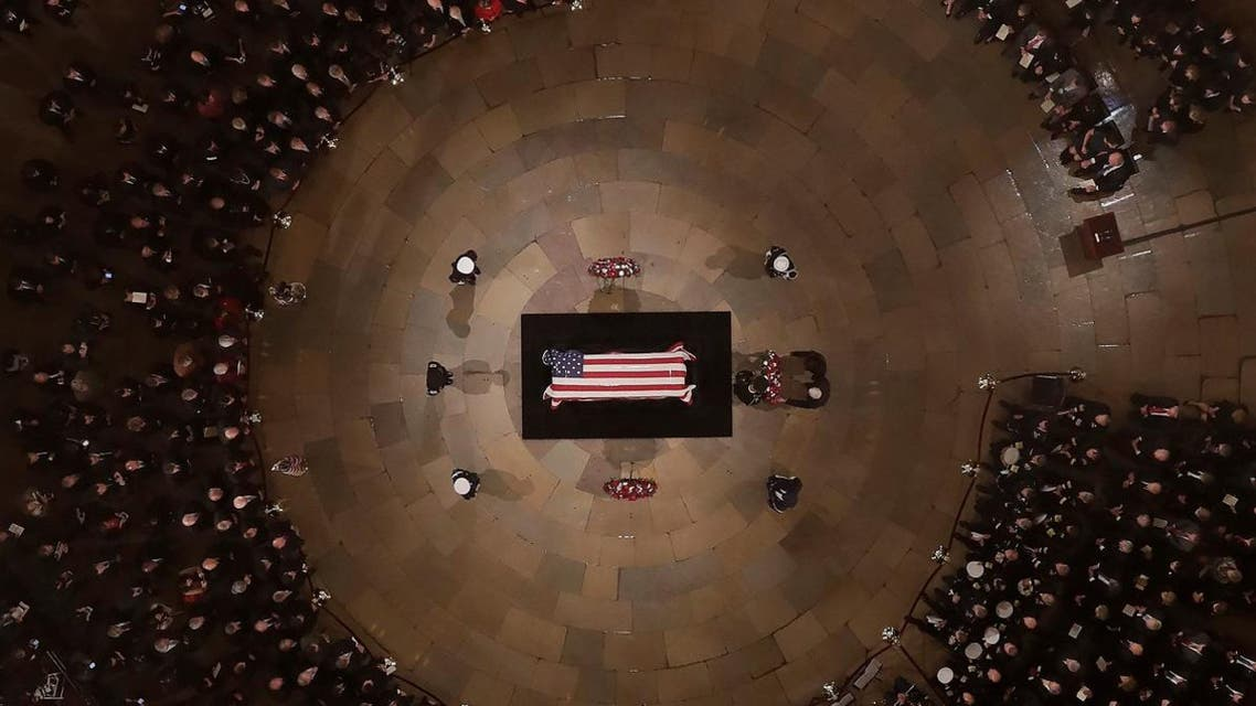 Vice President Mike Pence and wife Karen help lay a wreath as Former President George H. W. Bush lies in state in the US Capitol Rotunda Monday. (Reuters)
