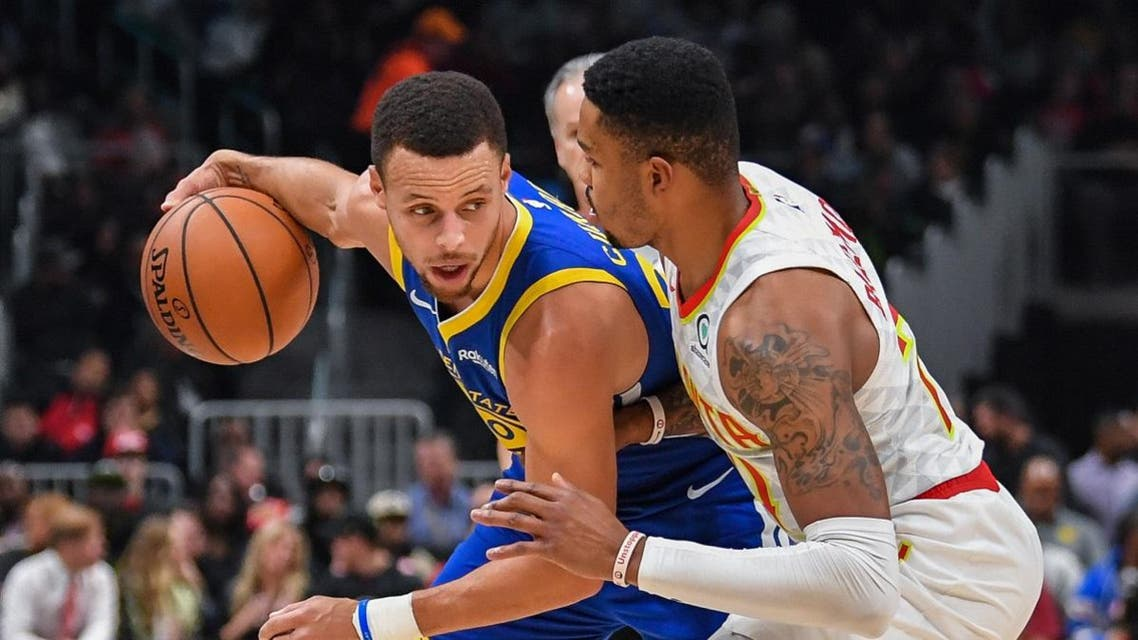 Golden State Warriors guard Stephen Curry (30) is guarded by Atlanta Hawks guard Kent Bazemore (24) during the first half at State Farm Arena. (Dale Zanine/USA TODAY Sports)