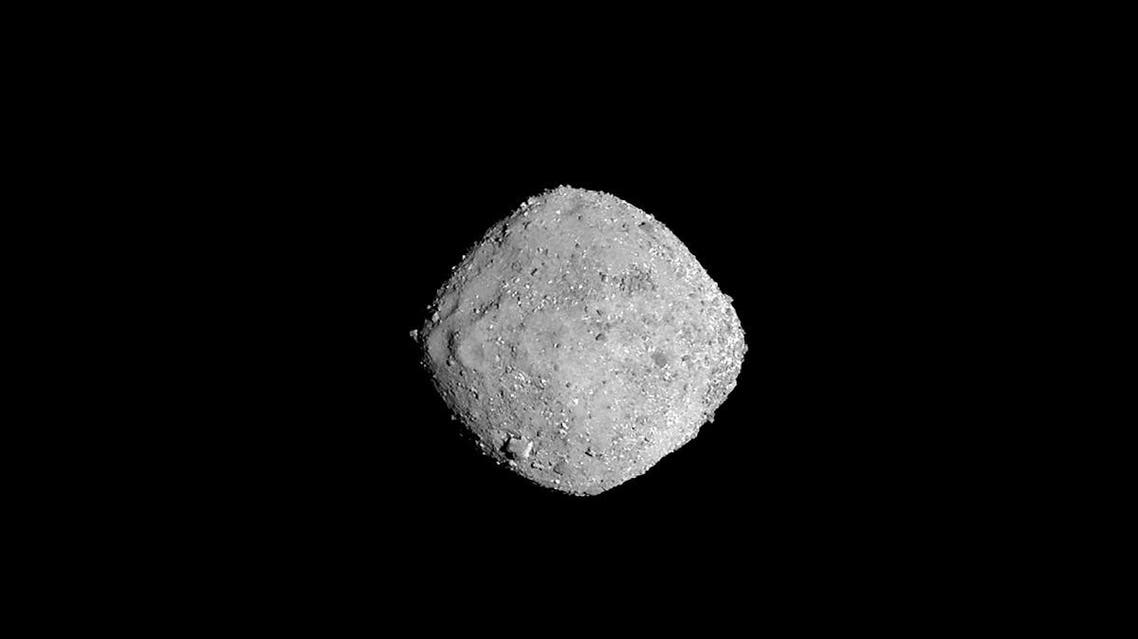 asteroid Bennu from a distance of 85 miles (136 km). (AFP)