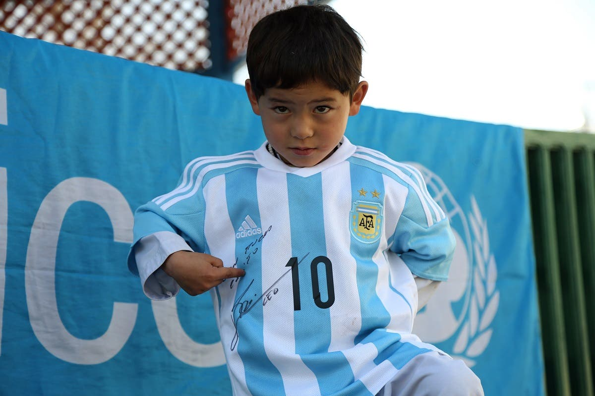 Afghani Muratza with Messi shirt (AFP)