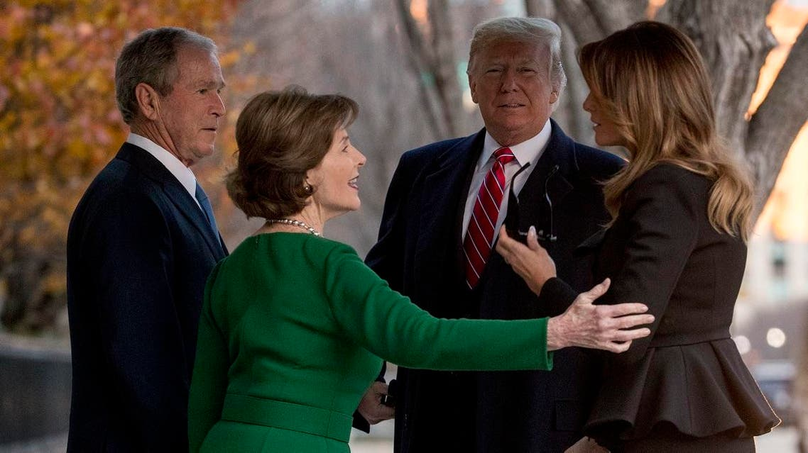 President Donald Trump, second from right, and first lady Melania Trump, right, are greeted by former President George Bush and former first lady Laura Bush outside the Blair House across the street from the White House in Washington, Tuesday, Dec. 4, 2018. (AP)