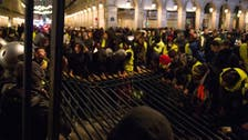 13 charged over sacking of Arc de Triomphe during Paris protests