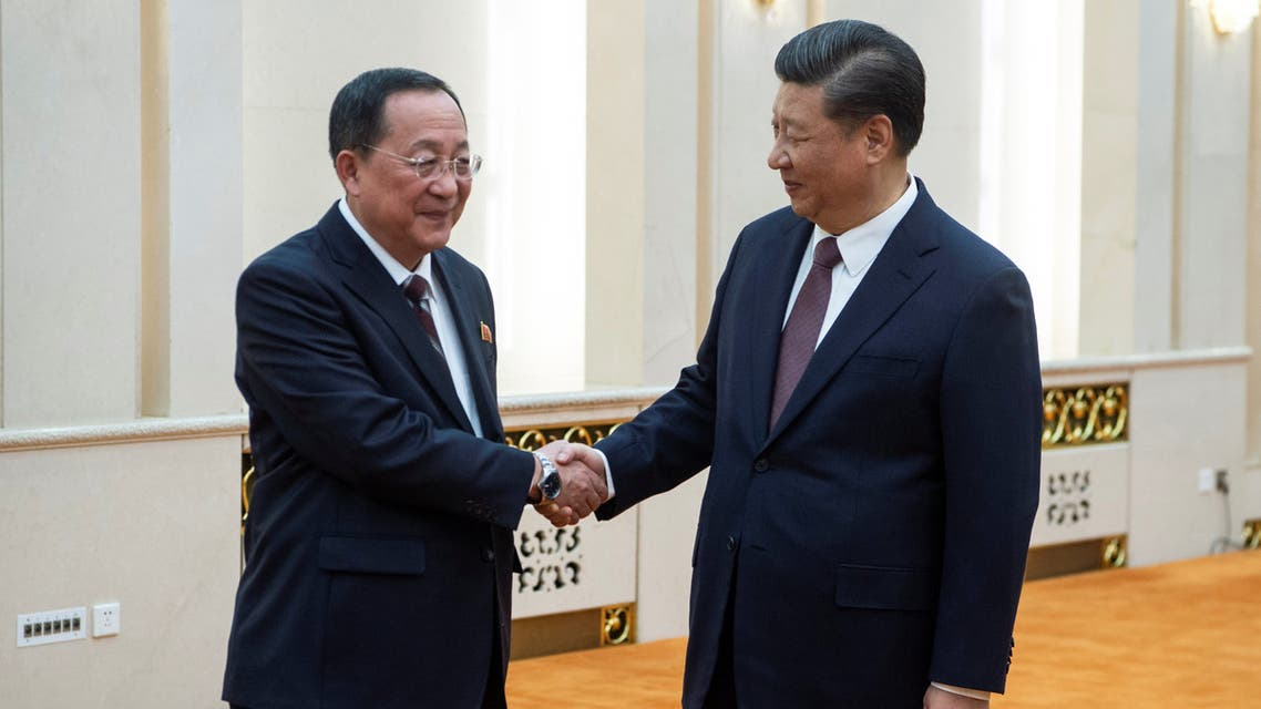 China's President Xi Jinping shakes hands with North Korean Foreign Minister Ri Yong Ho at the Great Hall of the People in Beijing, China December 7, 2018. Fred Dufour/Pool via REUTERS