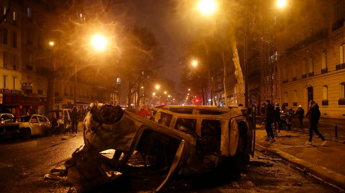 Charred cars are pictured after a demonstration on Saturday, December 1, 2018, in Paris. (AP)
