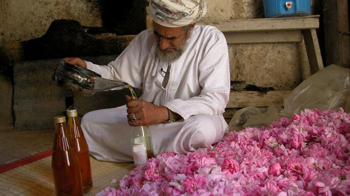 An Omani farmer working at his traditional rose distillation unit. (Supplied)