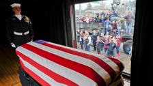 Former US President Bush's casket arrives in Texas for burial