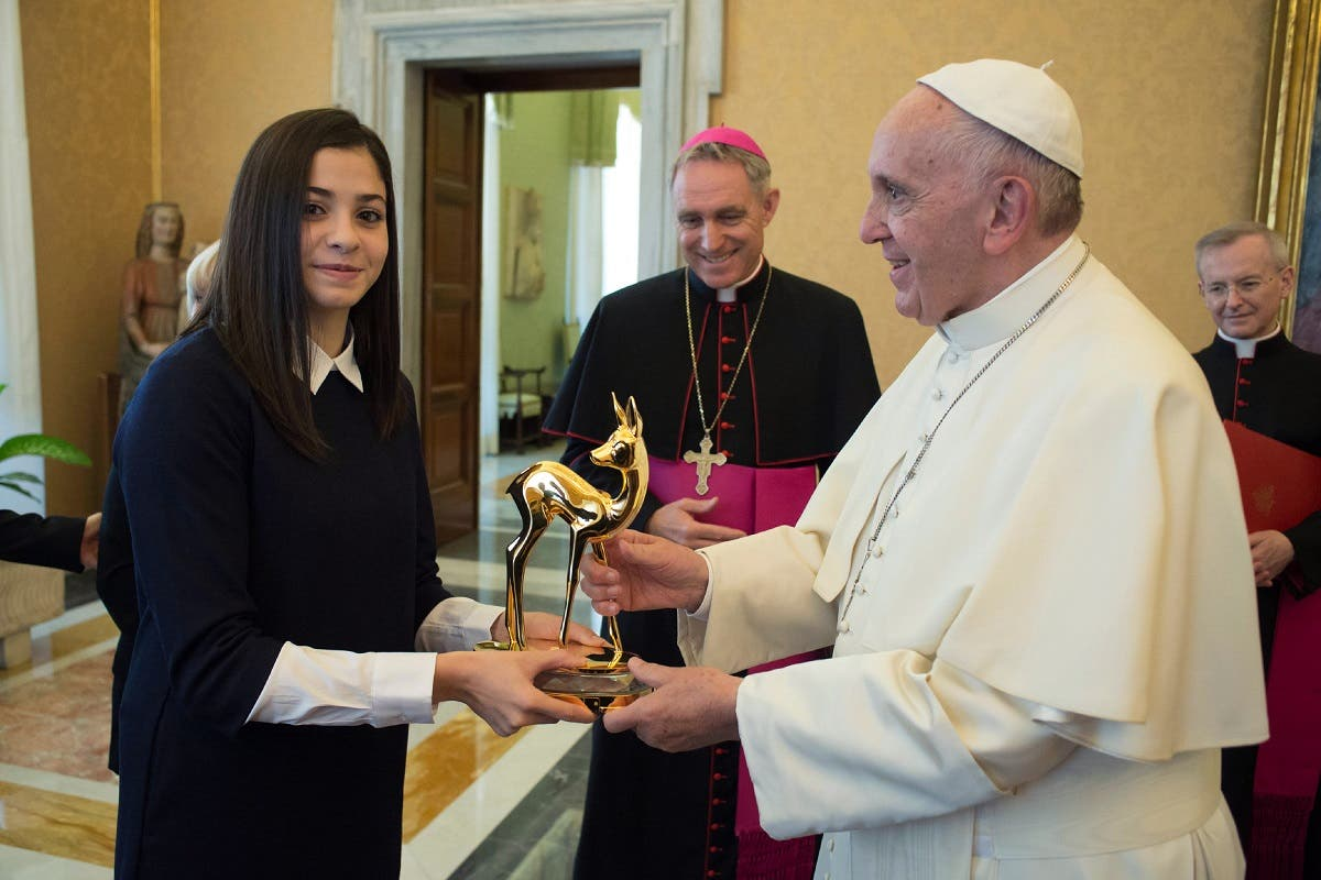 Syrian refugee mardini and Pope (AFP)