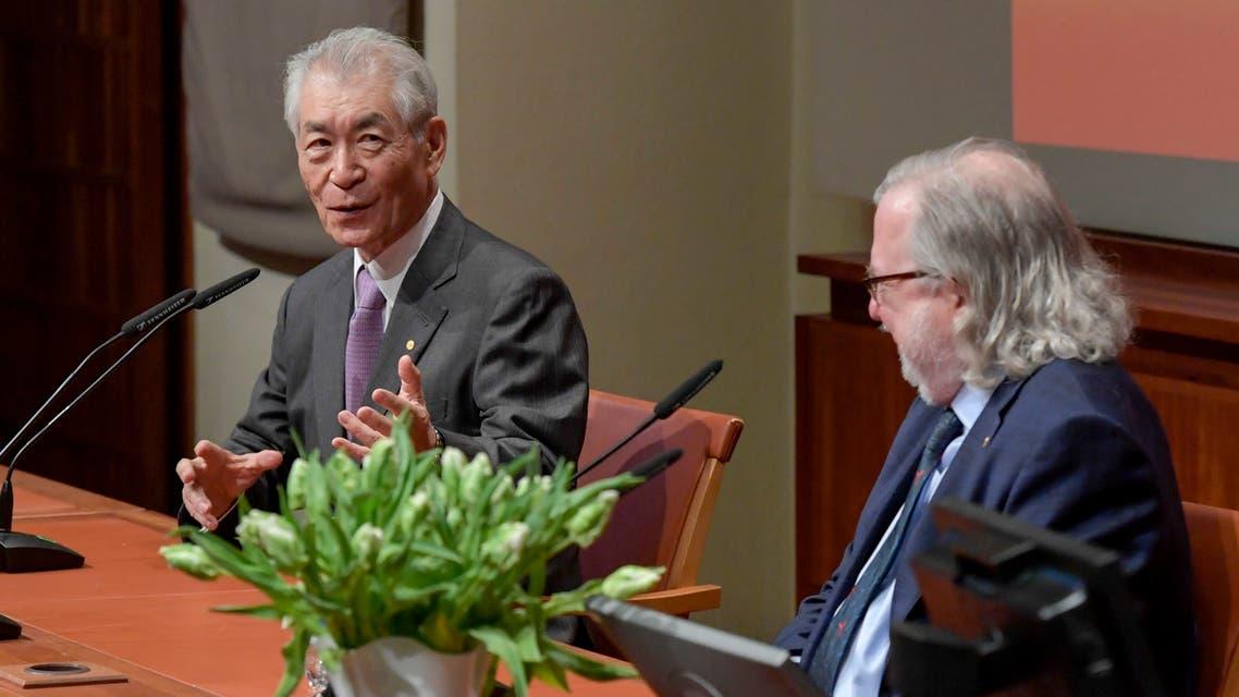 The 2018 Nobel Prize laureates in Physiology or Medicine Japanese scientist Tasuku Honjo (L) and James Allison attend a press conference at Karolinska Institutet in Stockholm, Sweden, on December 6, 2018.