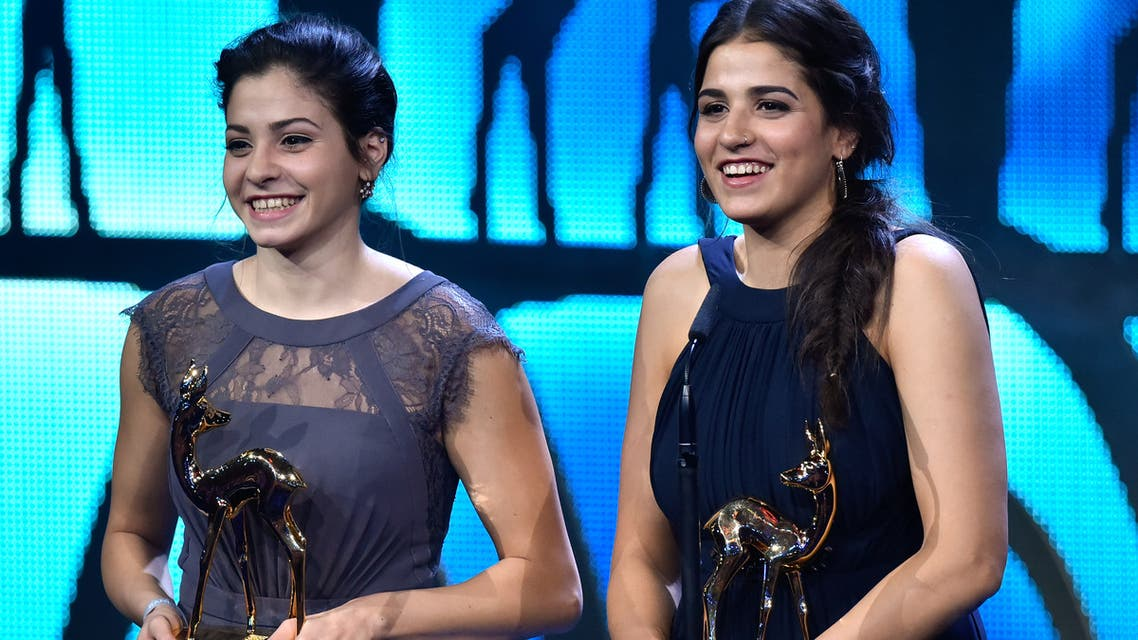 Syrian refugees and swimmers Yusra and Sarah Mardini receive the Bambi award on November 17, 2016 in Berlin. The Bambis are the main German media awards.