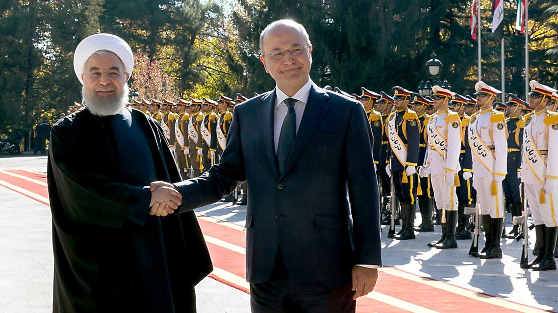 Iran's President Hassan Rouhani with Iraq's President Barham Salih (R) during a welcome ceremony in Tehran on November 17, 2018. (AFP)