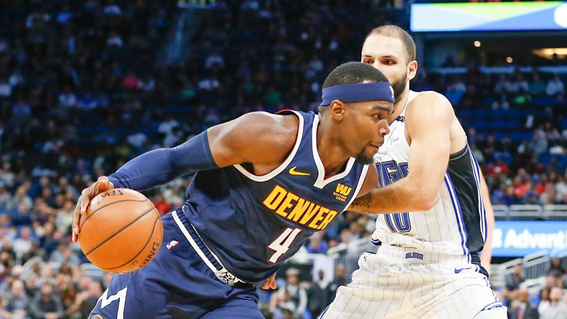 Denver Nuggets forward Paul Millsap (4) drives past Orlando Magic guard Evan Fournier (10) during the second half at Amway Center. (Reinhold Matay/USA TODAY Sports)