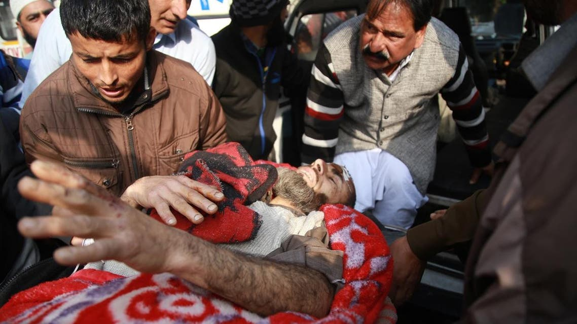 An injured passenger is brought to a hospital for treatment in Jammu on December 8, 2018. (AFP)