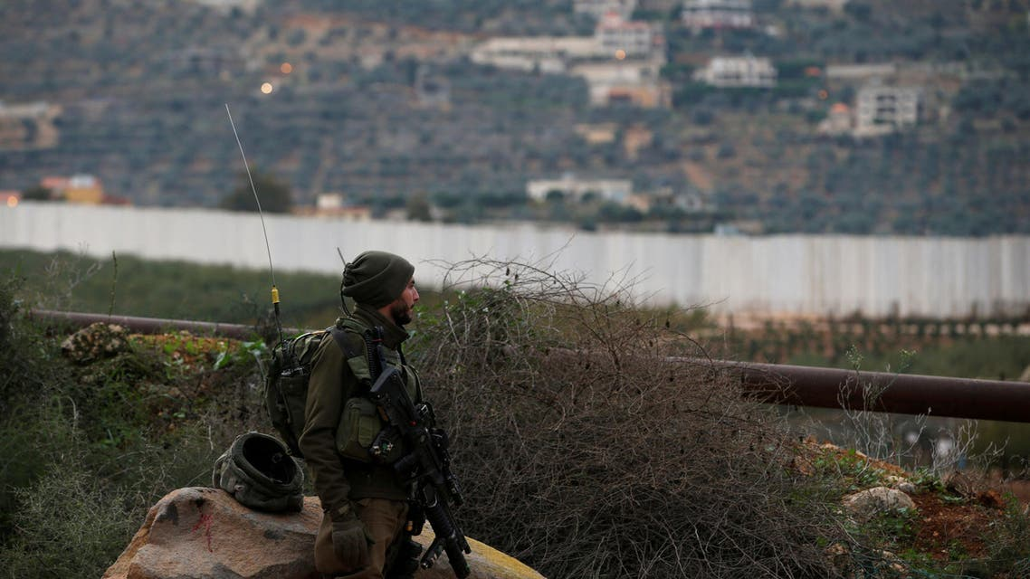 "FILE PHOTO: FILE PHOTO: An Israeli soldier guards near the border with Lebanon, the morning after the Israeli military said it had launched an operation to ""expose and thwart"" cross-border attack tunnels from Lebanon, in Israel's northernmost town Metula December 5, 2018. REUTERS/Ronen Zvulun/File Photo/File Photo"