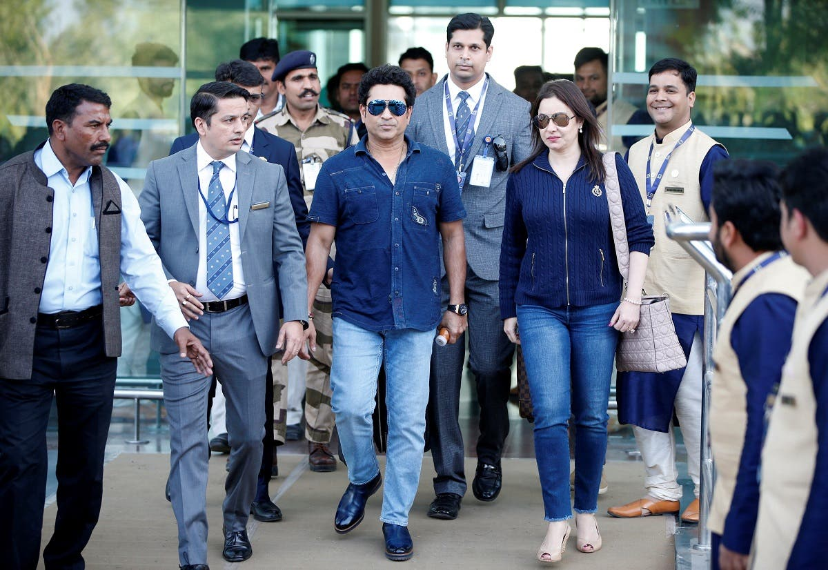 Former Indian cricketer Sachin Tendulkar and his wife Anjali arrive at the airport