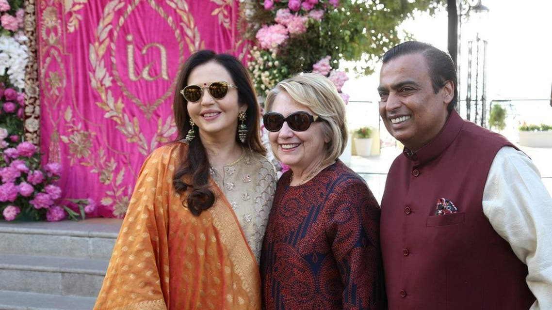 Former US Secretary of State Hillary Clinton poses with Mukesh Ambani, Chairman of Reliance Industries, and his wife Nita Ambani after her arrival in Udaipur in India to attend pre-wedding celebrations of their daughter Isha Ambani on December 8, 2018. (Reuters)