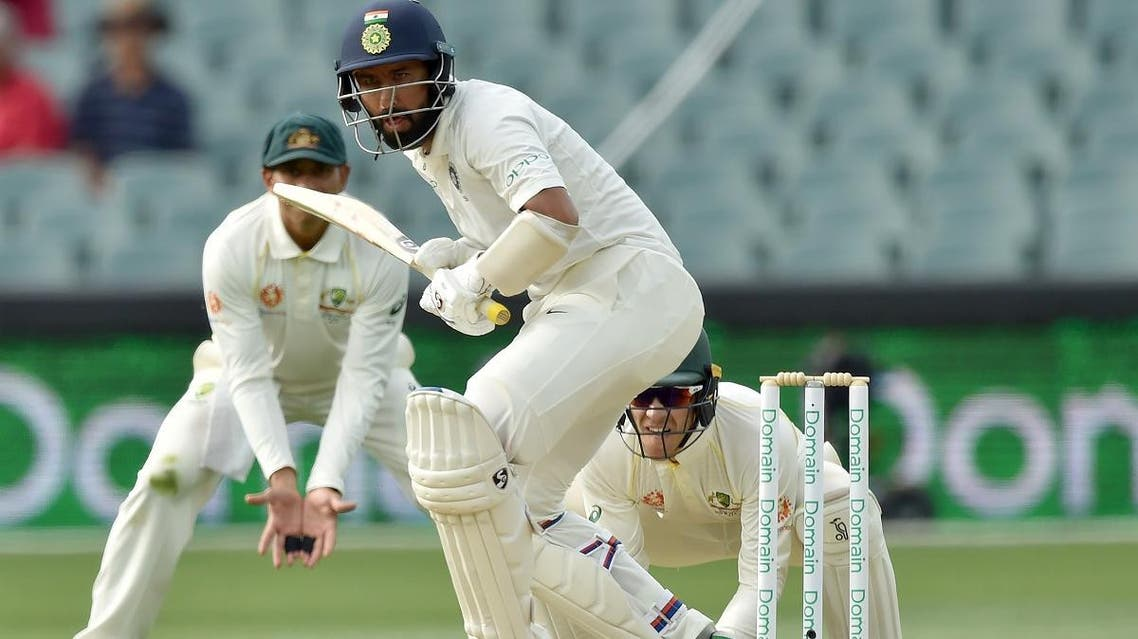 India's batsman Cheteshwar Pujara (C) bats against Australia during day three of the first Test cricket match at the Adelaide Oval on December 8, 2018. (AFP)