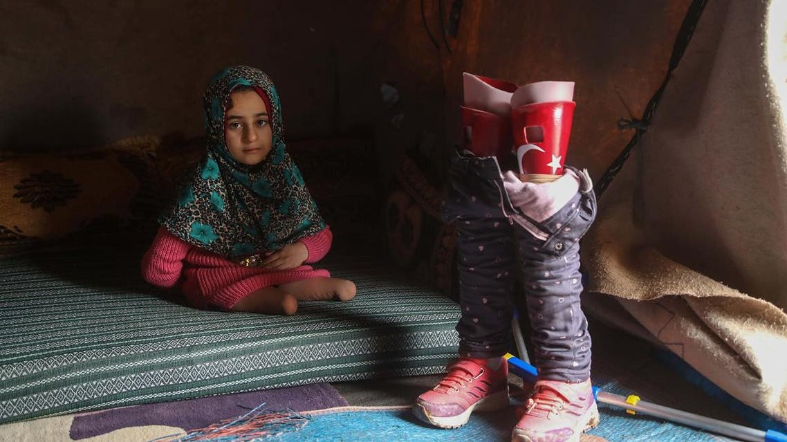 Syrian girl with prosthetic legs. (AFP)