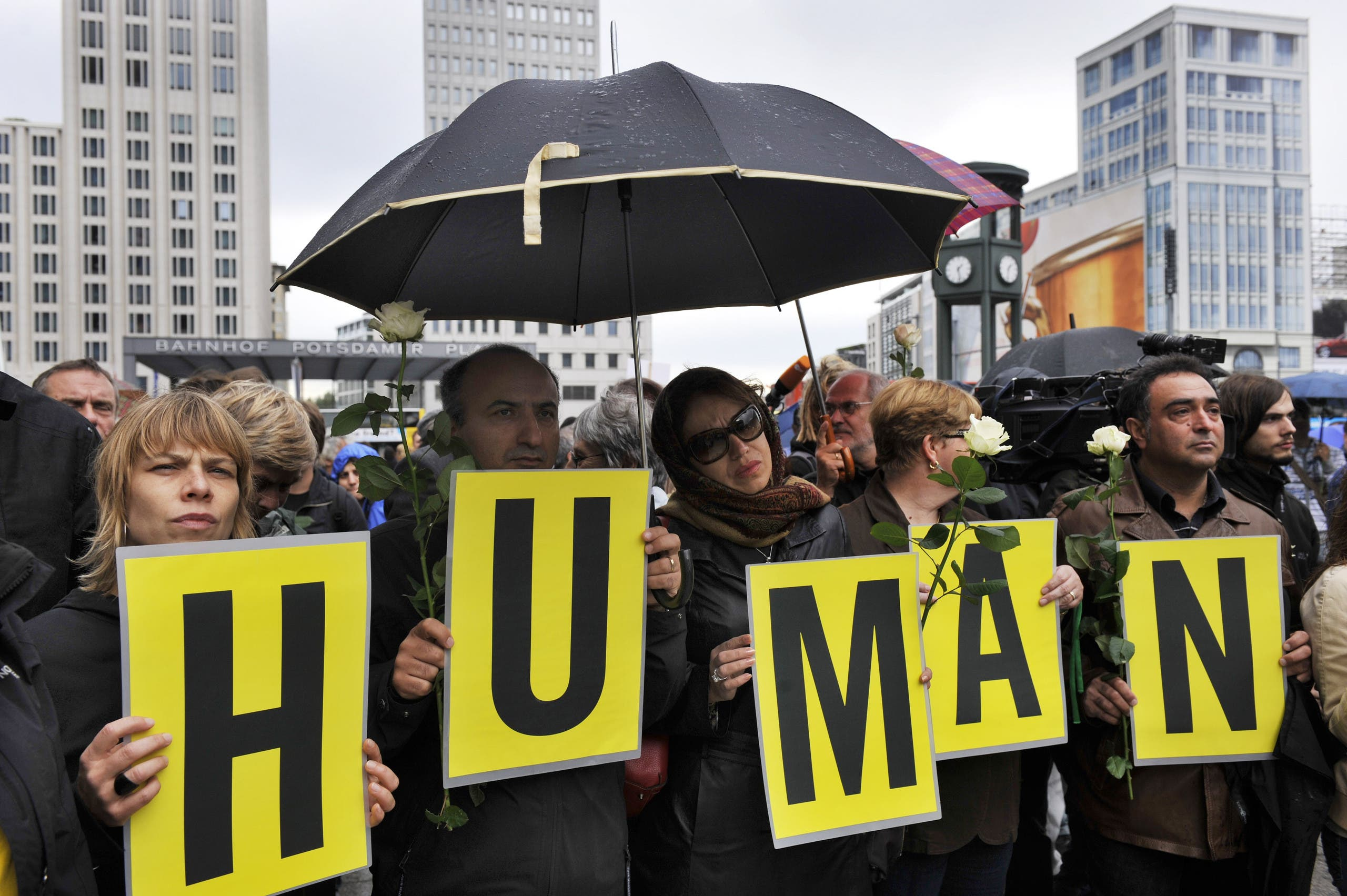"Protesters hold up letters, spelling ""Human Rights,"" during a rally to demand the release of political prisoners in Iran as part of a ""Global day of action"" in Berlin on July 25, 2009. (AFP)"