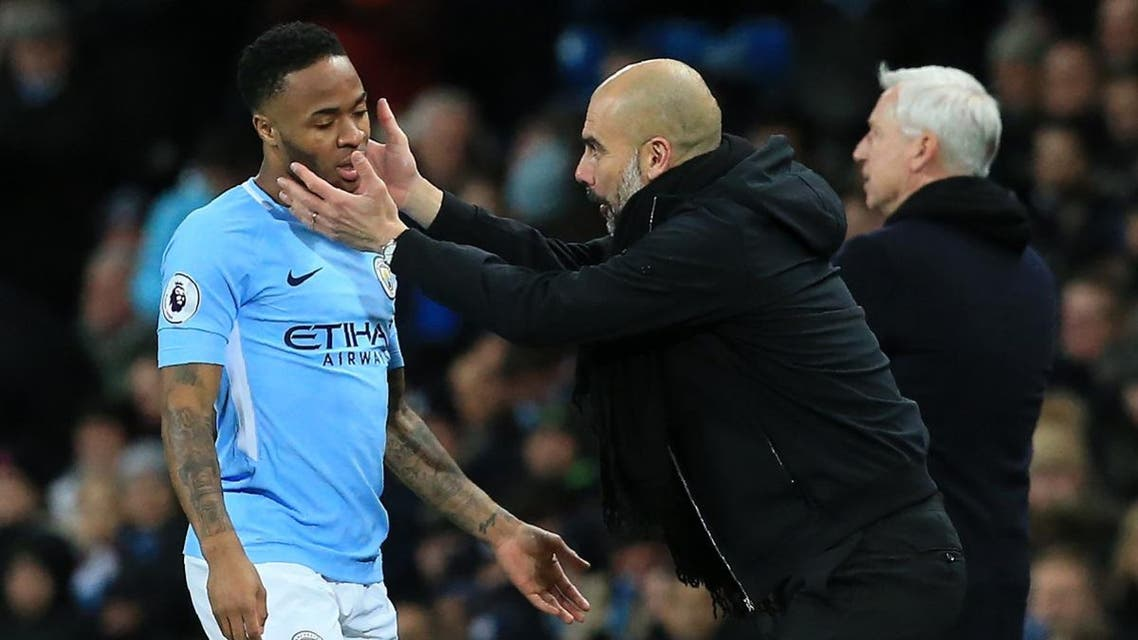 Manchester City's Spanish manager Pep Guardiola gestures to Manchester City's English midfielder Raheem Sterling. (AFP)