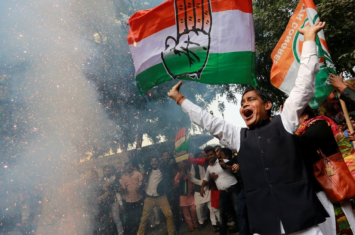 Supporters of India's main opposition Congress party celebrate after initial poll results at the party headquarters in New Delhi. (Reuters)