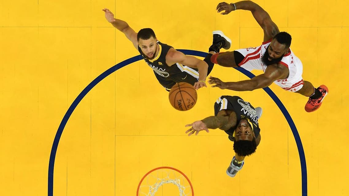 James Harden #13 of the Houston Rockets takes a shot over Stephen Curry #30 and Jordan Bell #2 of the Golden State Warriors during Game Four of the Western Conference Finals of the 2018 NBA Playoffs. (AFP)