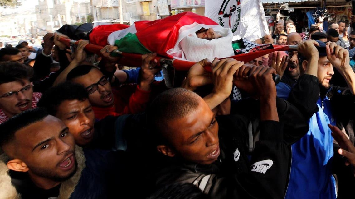 Mourners carry the body of Palestinian man Mohammed Habali during his funeral in Tulkarm refugee camp near Tulkarm in the occupied West Bank. (Reuters)