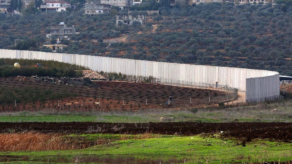 A picture taken on December 4, 2018 from a position near the southern Lebanese village of Kfar Kila shows a section of the concrete border wall between Lebanon (R) and Israel. (AFP)