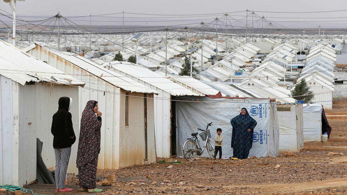 Syrian refugee women stand in front of their homes at Azraq refugee camp, near Al Azraq city, Jordan, December 8, 2018. REUTERS/Muhammad Ham