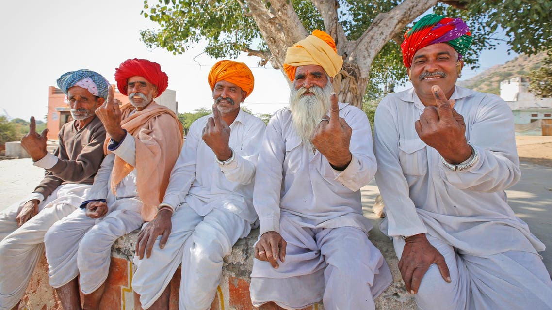 Rajasthani men show the indelible ink mark on their index fingers after casting their vote in village Padampura, near Ajmer on Dec. 7, 2018. (AP)