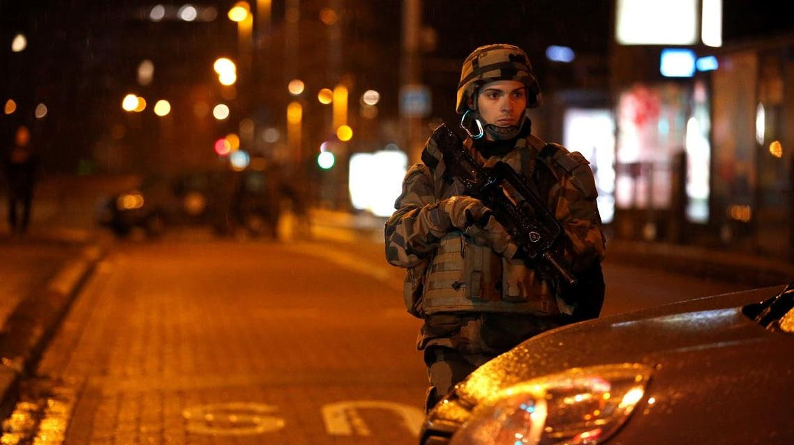 Soldier secures area where a suspect is sought after a shooting in Strasbourg. (Reuters)