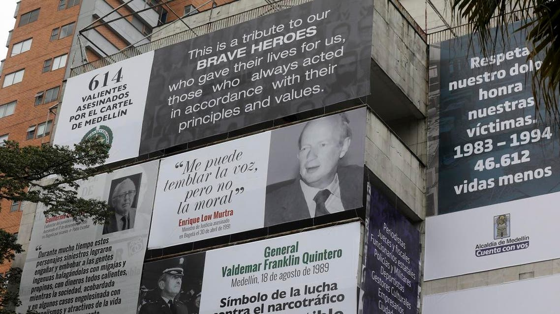 The Monaco building, which was once home to Colombian drug lord Pablo Escobar, is seen covered with pictures of victims of his Medellin Cartel, in Medellin, Colombia. (AFP)