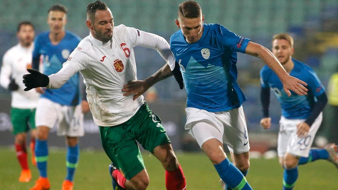 Slovenia's Jaka Bijol, right, challenges Bulgaria's Simeon Slavchev, during the Nations League soccer match at Vassil Levski stadium in Sofia, Monday, Nov. 19, 2018. (AP)