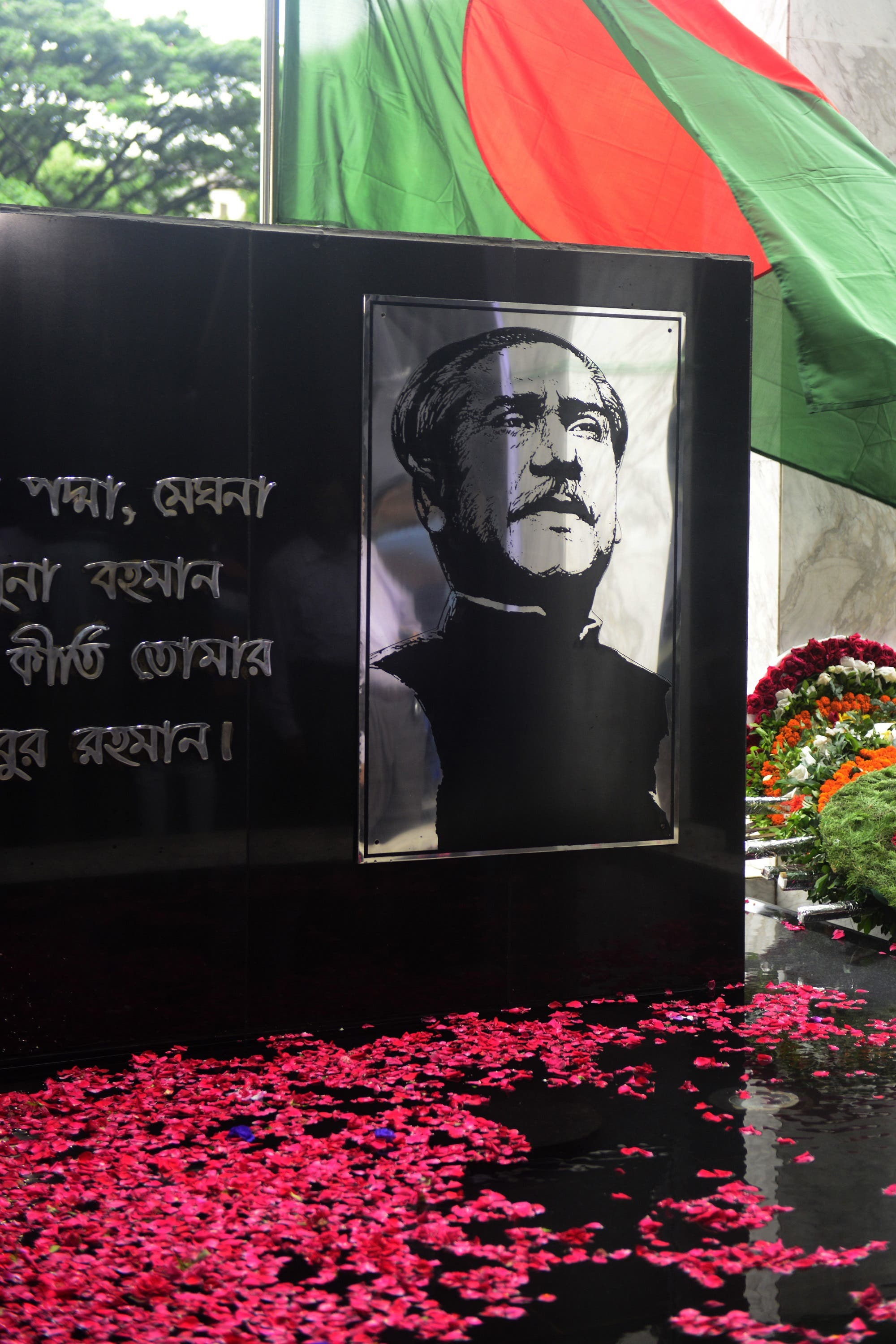The Sheikh Mujibur Rahman Memorial is covered with flower petals in Dhaka on August 15, 2013. (AFP)