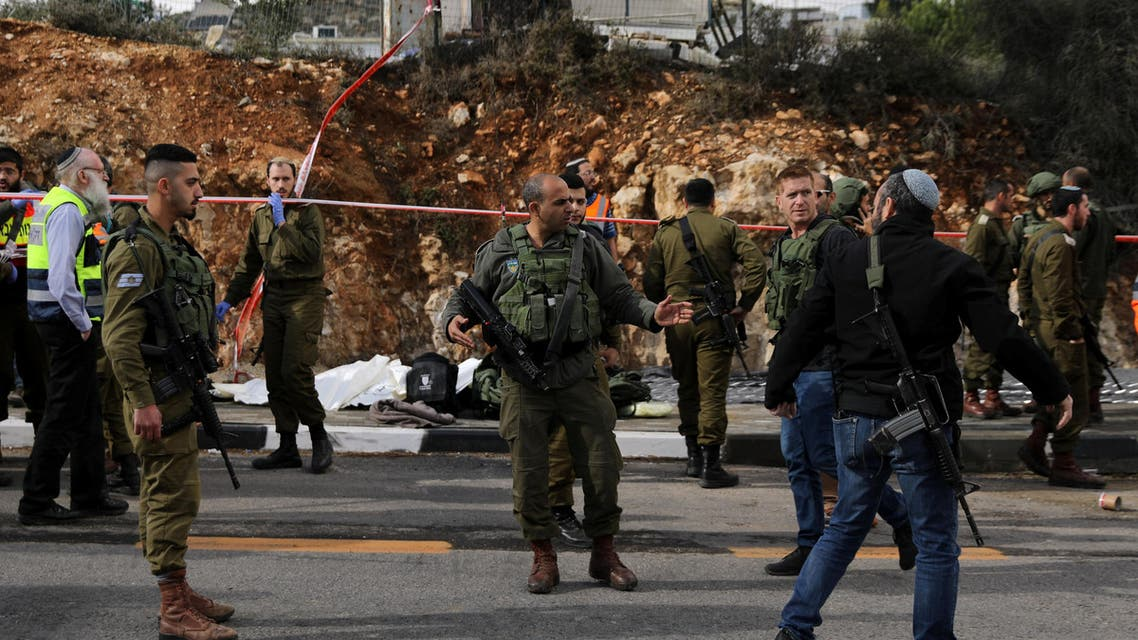 Israeli forces are seen at the scene of a shooting attack near Ramallah in the Israeli-occupied West Bank December 13, 2018. REUTERS/Ammar Awad