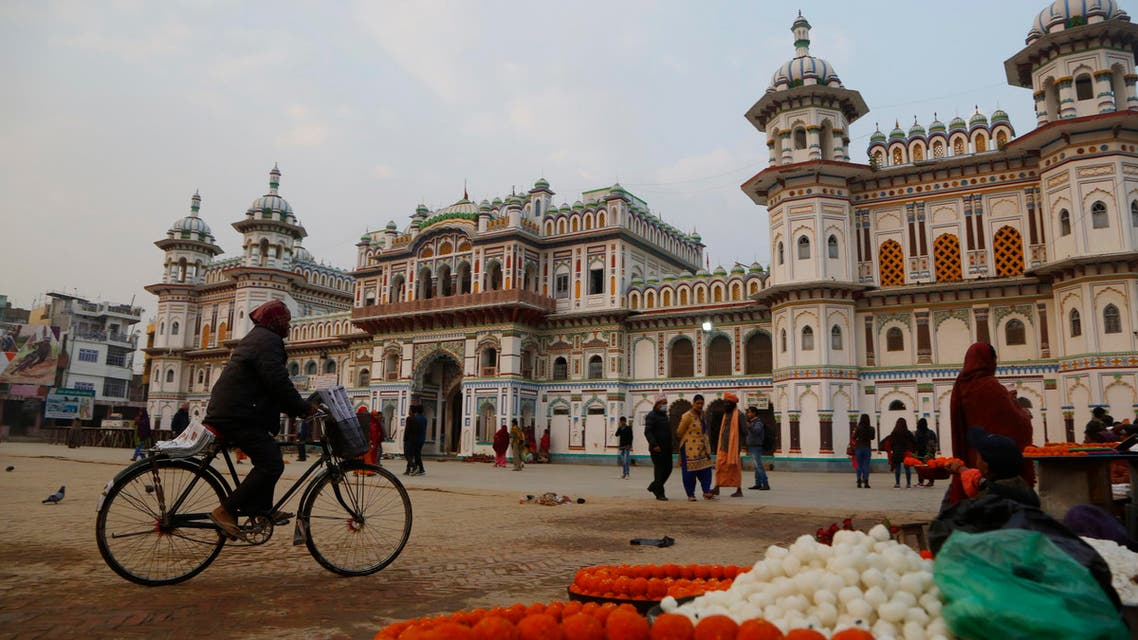 In this Nov. 30, 2018 photo, a Nepalese man rides his bicycle in front of the Ram Janaki temple in Janakpur, Nepal. (AP)