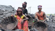In India, 13 feared dead in flooded 'rat hole' mine